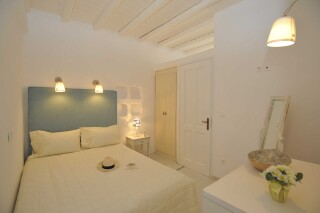one bedroom apartment with sea view navy blue suites bed