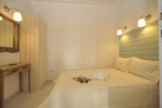 one bedroom apartment with sea view navy blue suites bedroom